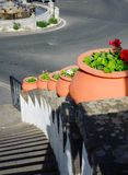 Ceramic pots with flowers. Stair decoration with Ceramic pots with flowers in Fergas town, Gran Canaria, Spain stock image