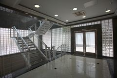 Stair and door in modern building Stock Photos