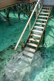 Stair down to crystal clear ocean from water villa private balcony, Maldive. S stock photography