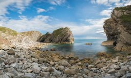 Stair Hole at Lulworth Cove on Dorset`s Jurassic Coast, England,. UK Royalty Free Stock Photography