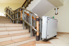 Stair lift for the disabled. Stairs of public building Royalty Free Stock Photography