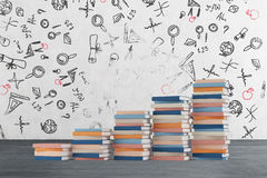 A stair is made of colourful books. Educational icons are drawn on the concrete wall. stock illustration