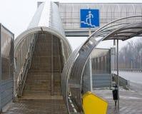 Stair pedestrian crossing under snowfall. Ladder crosswalk and bus stop under snowfall Stock Images