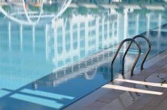 Stair in pool. Metal stair in pool hotel Royalty Free Stock Photo