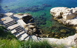 Stair step into into the water at adriatic sea in Rovinj,Croati. Stair step into into the clear water at adriatic sea in Rovinj,Croatia stock image