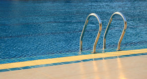 Stair of swimming pool. With blue water Royalty Free Stock Images
