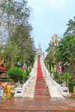 Stair to Golden pagoda for year of tiger at  Wat Prathat Cho Hae Temple, Phrae, Thailand royalty free stock photography