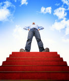 Stair to success. Standing man and stair with red carpet Royalty Free Stock Images
