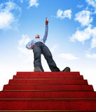 Stair to success. Standing man and stair with red carpet Stock Images