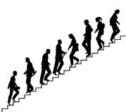 Stair walkers. Editable vector silhouette of people on stairs with all elements as separate objects Stock Photo