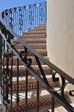 Stair way to the sky. Outdoor stairway with handrail and Mexican tile design stock image