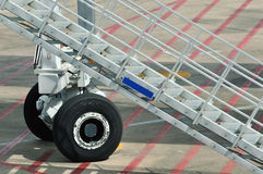 Stair with wheel as facility using in airport. Stair with wheel as facility for airport using, shown as working and operations in airport, detail of equipment Stock Images