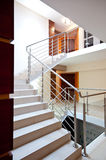 Staircase. Clean modern interior staircase with handrail Stock Photo