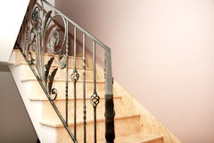 Staircase. Marble steps end steel decorative elements royalty free stock image