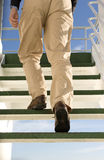 Staircase. A man walking up the stairs on a cruise ship Royalty Free Stock Photos