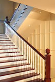 Staircase. With red wood railings in the middle of a house stock images