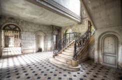 Staircase at an abandoned castle. This staircase in an abandoned castle in France, right in the middle of a field, is a catch for the eye stock image