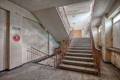 Staircase in an abandoned and forgotten building. Forgotten staircase in a ruined building Royalty Free Stock Images