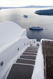 Staircase against ships on Santorini island in Greece Stock Images