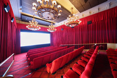 Staircase, baffle and seats in picture show hall. Staircase, baffle and red soft seats in picture show hall with big lusters Stock Images
