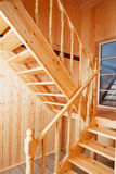 Staircase and banisters. Inside of wooden house royalty free stock photo