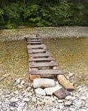 Staircase-bridge. Staircase-bridge lies through a small mountain river in the summer stock photography