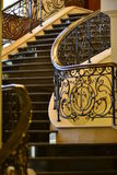 Staircase with carved handrails. Indoor staircase with carved handrails stock photo
