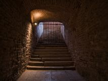 Staircase in cellar vault locked with a grid stock images