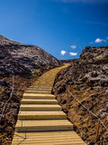 Staircase climbing to top of a volcano Royalty Free Stock Images