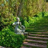 Staircase covered with ivy and sculpture. In the Santa Clotilde Gardens in Lloret de Mar stock image