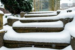 Staircase covered with snow in the winter garden stock images