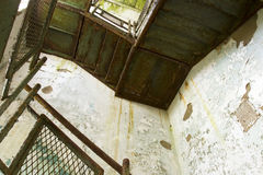 Staircase in decaying building Stock Photo