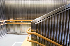 Staircase decoration. Metal wall decoration and handrails at train station stock photo