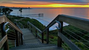 Staircase descending to the beach at sunset Stock Photo
