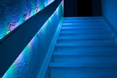 Staircase in dimmed gloomy blue light royalty free stock photography