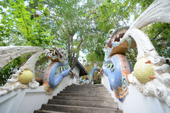Staircase with dragon statue Stock Photos