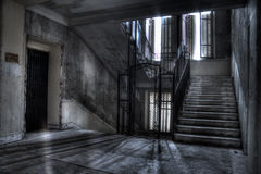 Staircase and elevator shaft shadows and light. Staircase and old elevator at the hotel Royalty Free Stock Images