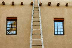 A staircase on a facade of a building in Taos , New Mexico royalty free stock photography