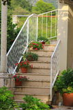 Staircase with flowers pots. Beautiful decoration for outdoor staircase with flowers in pots stock image