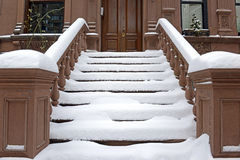 Staircase in front of New York Brownstone Building. Snow covered Staircase in front of New York Brownstone Building Royalty Free Stock Photos
