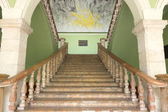 Staircase in Government Palace, Merida, Mexico. Beautiful old staircase leading to second floor of government palace in Merida, Mexico with famous painting by Royalty Free Stock Photo