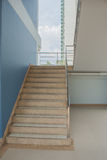 Staircase with a handrail. Staircase with a handrail in a buildings royalty free stock photography