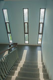 Staircase with a handrail in a buildings. Staircase with a handrail in a buildings and sunlight through window background royalty free stock photography