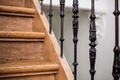 Staircase Handrailing in Old Historic Building. Interior Decor of Vintage Stairs with Metal Ornament and White Wall Background. House Design Detail of stock photos