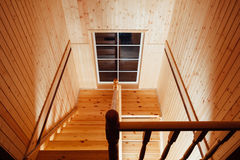 Staircase and handrails. Inside of wooden house Stock Photos