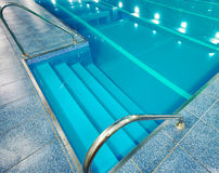 Staircase with handrails into the pool Royalty Free Stock Photography