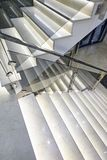 Staircase with illumination. And glass railing in the building royalty free stock images