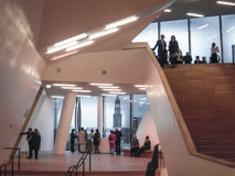 Elbphilharmonie Hamburg. Staircase inside Hamburg`s new concert house the Elbphilharmonie during intermission time, In the background The Michel Royalty Free Stock Image