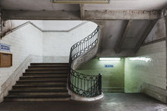 Staircase inside an old building. Empty staircase with neon light inside an old building Stock Photography