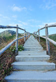 Staircase lead to heaven. Stone staircase with handrails in mountain lead to blue sky royalty free stock photography